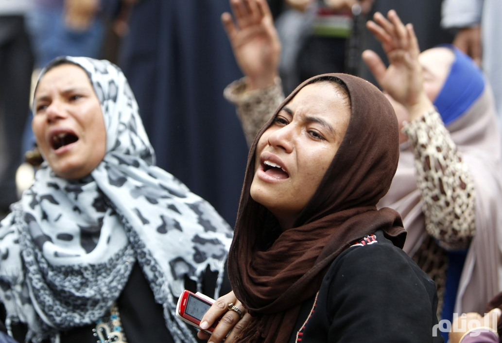Relatives and families of members of the Muslim Brotherhood and supporters of ousted President Mursi react in front of the court in Minya