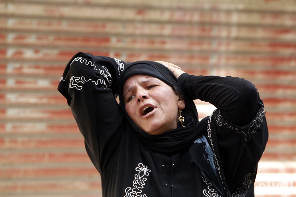 The mother of an accused supporter of ousted President Mursi reacts in front of the court in Minya
