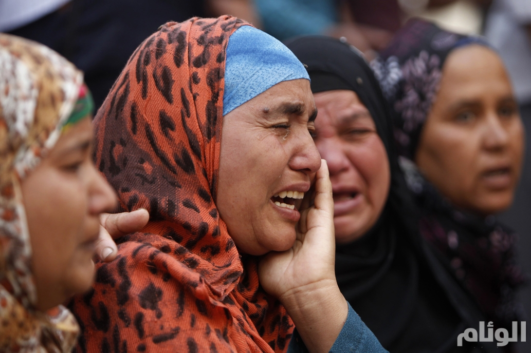 Relatives and families of Muslim Brotherhood members and supporters of ousted President Mursi react in front of the court in Minya