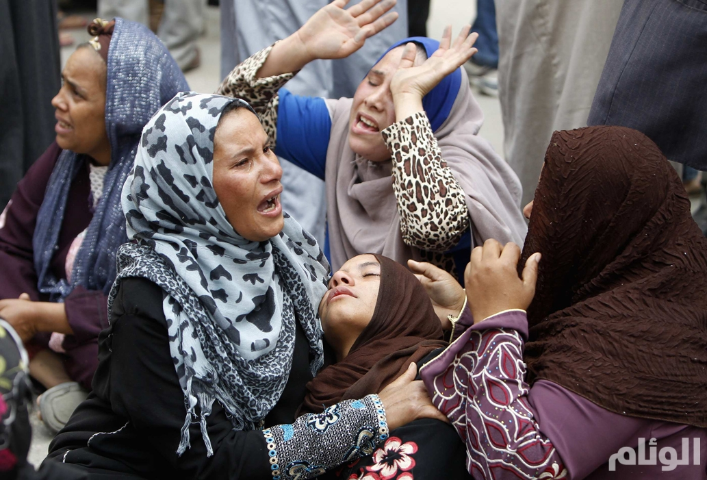 Relatives and families of members of Muslim Brotherhood and supporters of ousted President Mursi react after hearing the sentence, in front of the court in Minya, south of Cairo
