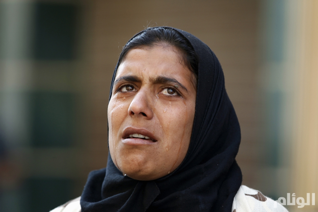 A woman reacts outside a court in Minya, south of Cairo, after the sentences of Muslim Brotherhood leader Mohamed Badie and his supporters were announced