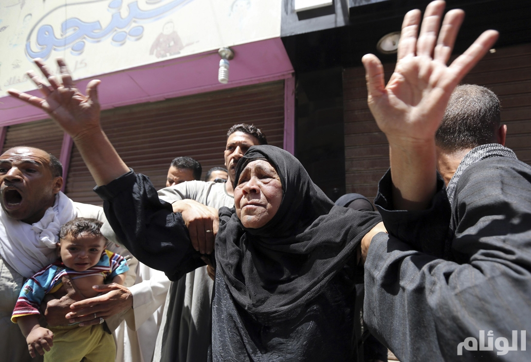 Relatives and families of members of the Muslim Brotherhood and supporters of ousted Egyptian President Mursi react outside the court in Minya, south of Cairo