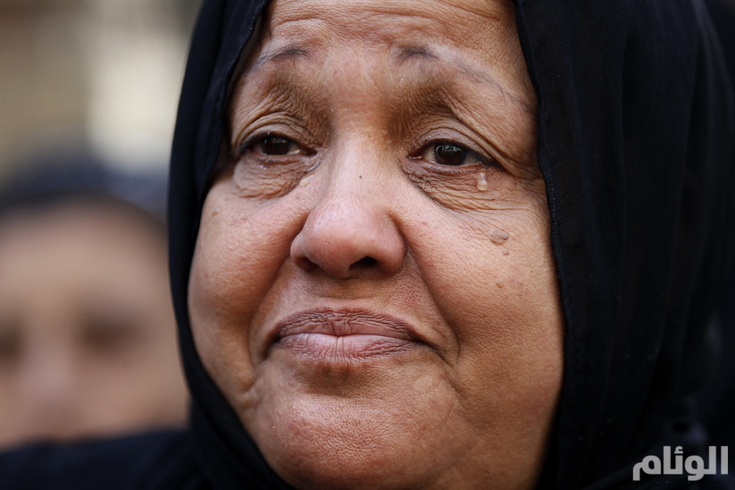 A woman reacts outside a court in Minya, south of Cairo