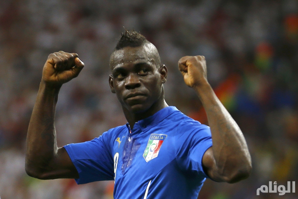 Italy's Mario Balotelli celebrates after goal past England during World Cup soccer match at the Amazonia arena