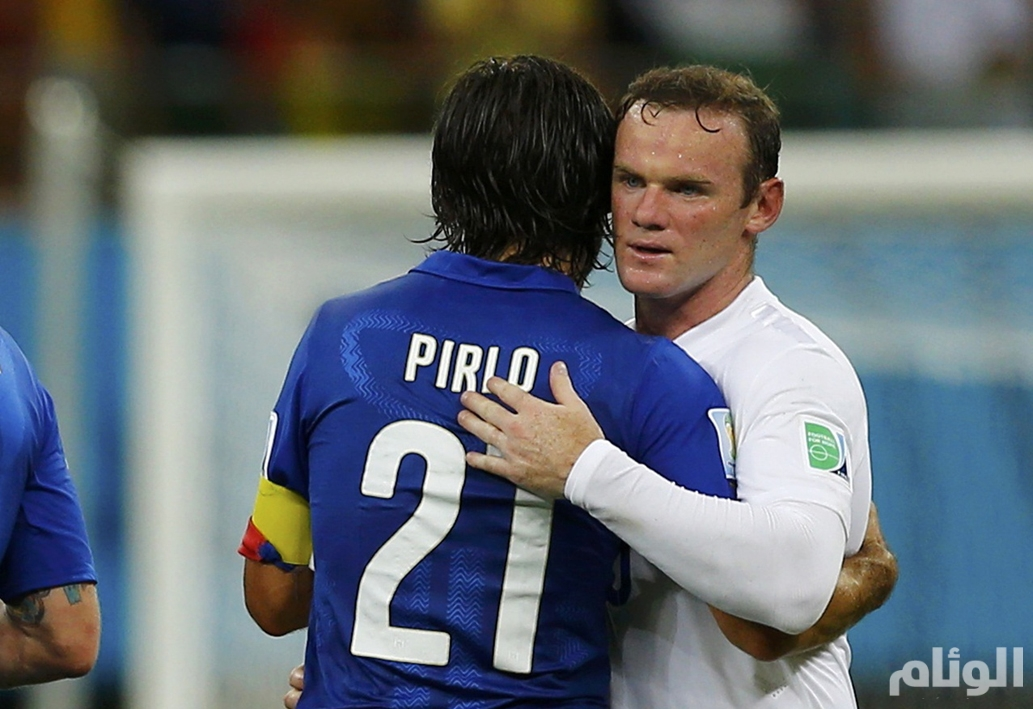 England's Rooney and Italy's Pirlo embrace after their 2014 World Cup Group D soccer match at the Amazonia arena in Manaus