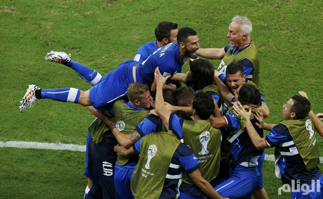 Italy's national soccer players celebrate a goal scored by Claudio Marchisio during their 2014 World Cup Group D soccer match against England at the Amazonia arena in Manaus