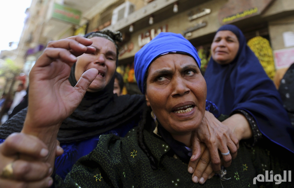 Relatives and families of members of the Muslim Brotherhood and supporters of ousted Egyptian President Mursi react outside a court in Minya, south of Cairo