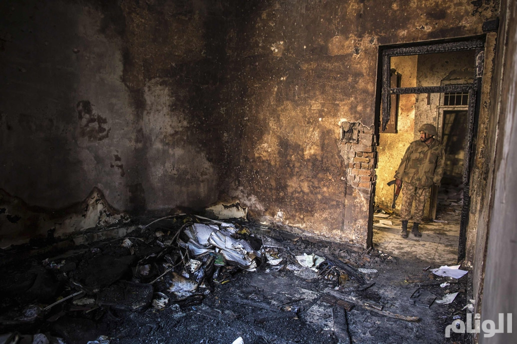 An army soldier stands in the Army Public School, which was attacked by Taliban gunmen, in Peshawar