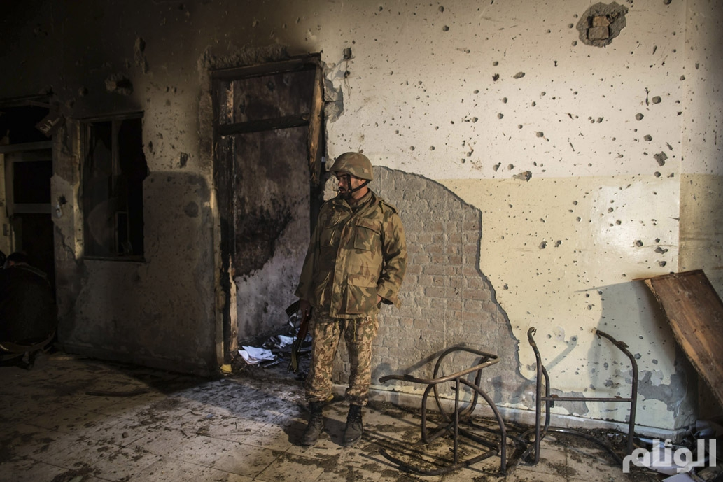 An army soldier inspects the Army Public School, which was attacked by Taliban gunmen, in Peshawar