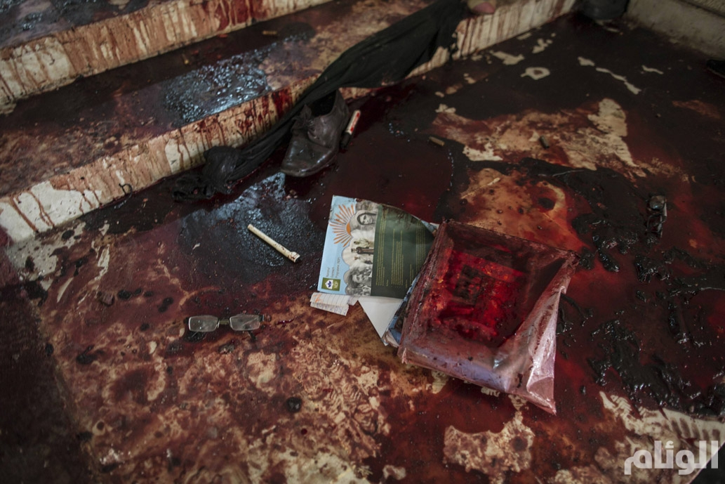 Books lie in blood on the auditorium floor at the Army Public School, which was attacked by Taliban gunmen, in Peshawar