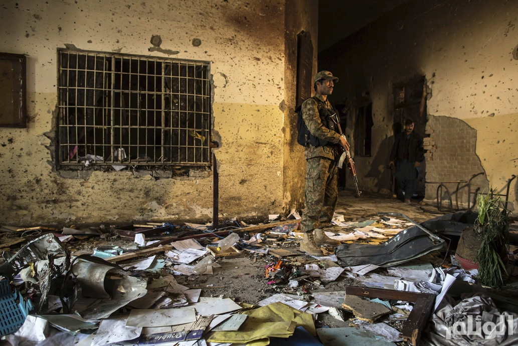 An army soldier stands inside the Army Public School, which was attacked by Taliban gunmen, in Peshawar