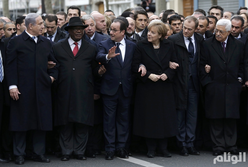 French President Hollande is surrounded by heads of state as they attend the solidarity march in the streets of Paris