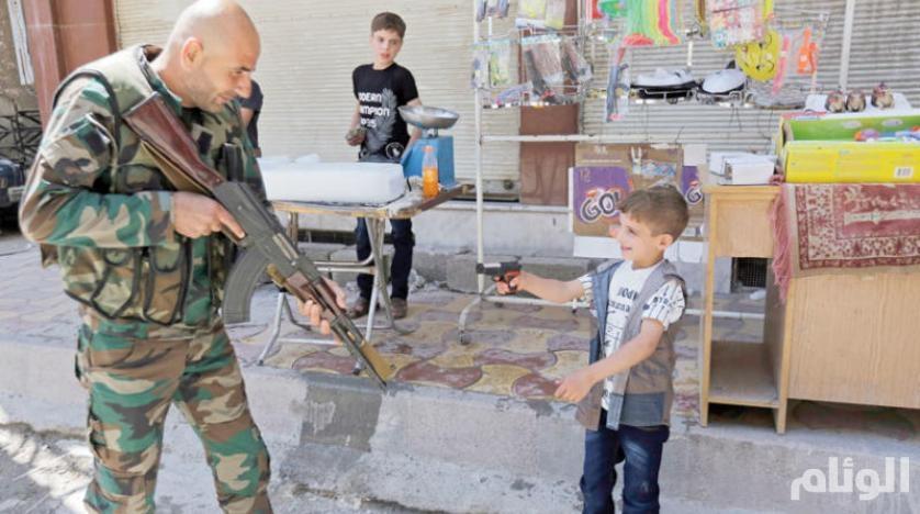 طفل يواجه جندي سوري في درعا