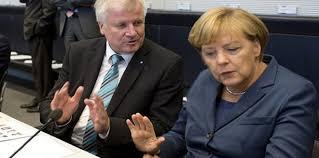 ميركل تروض وزير الداخلية الألماني و تقنعه بالتراجع عن الاستقالة